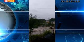Se queda atorado en inundación presunto transporte escolar