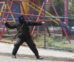 Encapuchados armados chocan con manifestantes en Managua